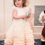 "Izabela in rochita unicat, ""Little Princess"" relizata special pentru Lansarea oficiala a marcii Petite Coco (cunoscuta in presa sub numele de ""rochita de 1000 euro"")."